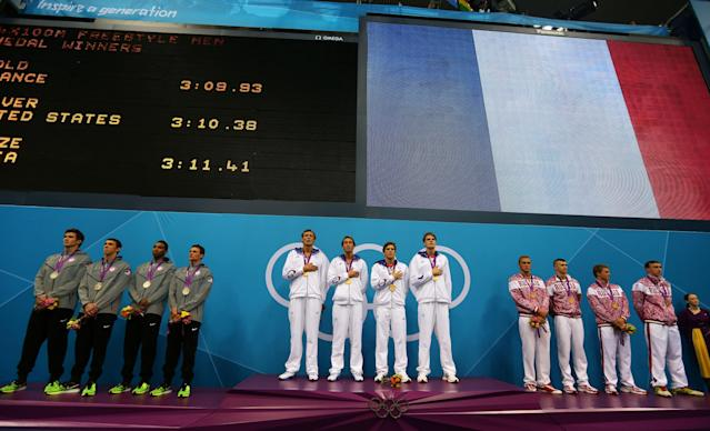 LONDON, ENGLAND - JULY 29: (L-R) The United States (silver), France (gold) and Russia (bronze)pose with the medals won in the Men's 4 x 100m Freestyle Relay final on Day 2 of the London 2012 Olympic Games at the Aquatics Centre on July 29, 2012 in London, England. (Photo by Clive Rose/Getty Images)