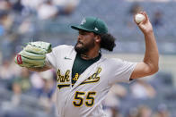 Oakland Athletics starting pitcher Sean Manaea (55) winds up during the first inning of a baseball game against the New York Yankees, Sunday, June 20, 2021, at Yankee Stadium in New York. (AP Photo/Kathy Willens)