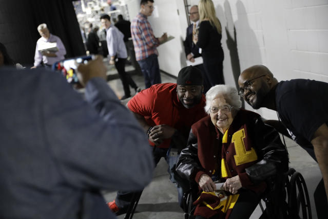 Sister Jean Dolores Schmidt poses with fans in Atlanta. (AP Photo/David Goldman)