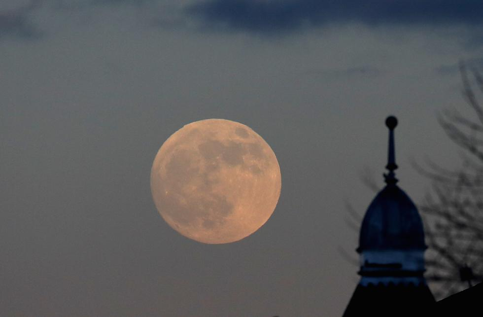 <p>A supermoon rising over Huddersfield (Picture: PA) </p>