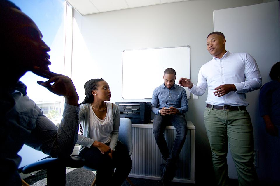 A small group of African business colleagues informal office discussion in Cape Town South Africa