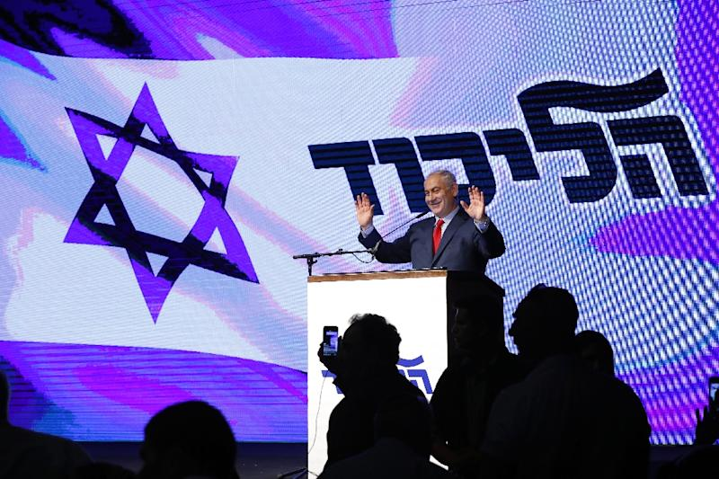 Israeli Prime Minister Benjamin Netanyahu addresses members of his right-wing Likud party gathered at a mass rally in Tel Aviv on August 9, 2017 to support him against persistent corruption allegations (AFP Photo/Jack GUEZ)