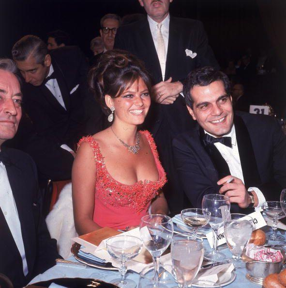 <p>Italian Actress Claudia Cardinale brought the heat to the 1966 awards with this stunning plunging coral-red gown. </p>