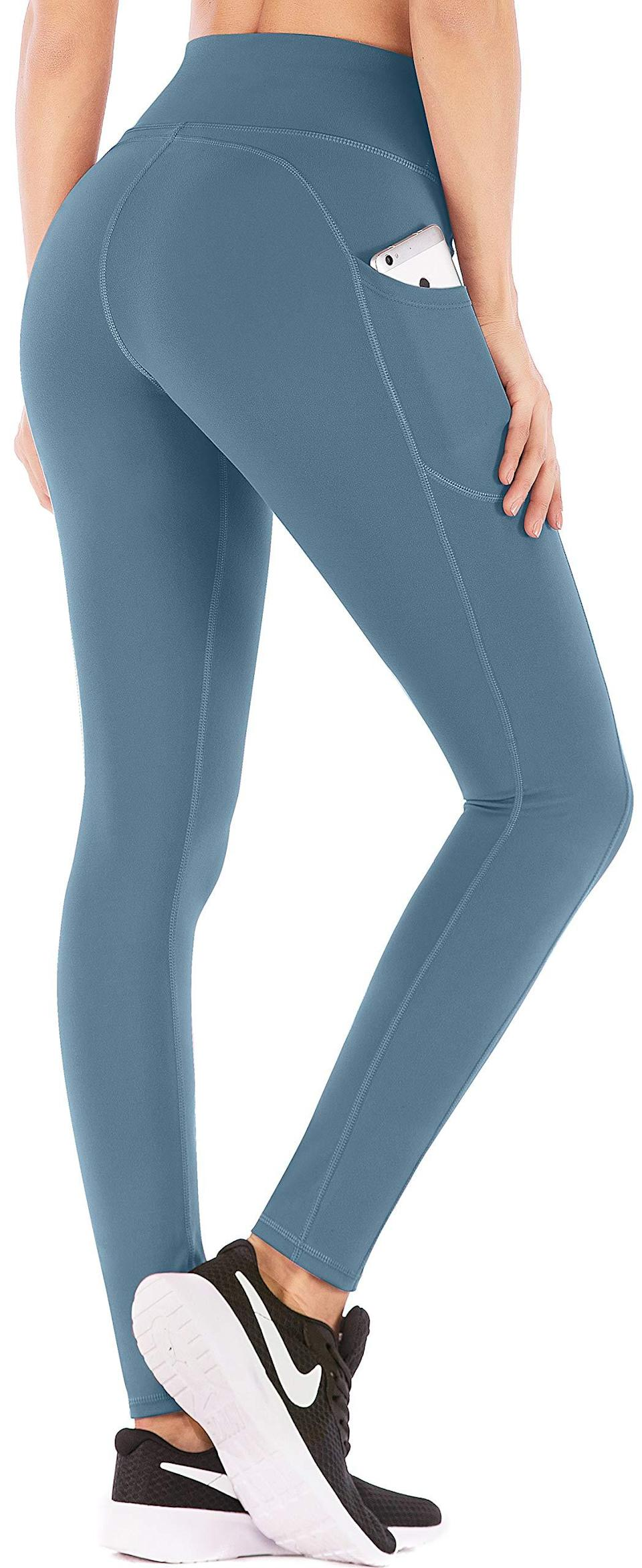 """<br><br><strong>IUGA</strong> High Waist Leggings With Pockets, $, available at <a href=""""https://amzn.to/3vy1sNT"""" rel=""""nofollow noopener"""" target=""""_blank"""" data-ylk=""""slk:Amazon"""" class=""""link rapid-noclick-resp"""">Amazon</a>"""