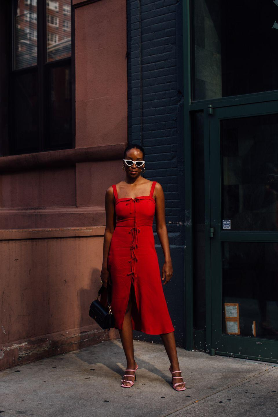 <p>Chrissy Rutherford paired a Reformation dress with strappy heels and white sunglasses.</p>