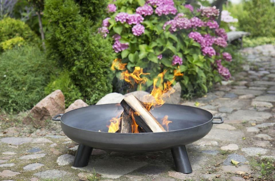 """<p>Stay warm as the sun goes down with a <a href=""""https://www.housebeautiful.com/uk/garden/g32185721/fire-pit/"""" rel=""""nofollow noopener"""" target=""""_blank"""" data-ylk=""""slk:fire pit"""" class=""""link rapid-noclick-resp"""">fire pit</a>, fire bowl, chiminea or an outdoor heater. Brilliant for summer entertaining, they are a stylish way to cosy up after hours. If you only buy one item this summer, why not make it this fire bowl...<br></p><p>Pictured: <a href=""""https://go.redirectingat.com?id=127X1599956&url=https%3A%2F%2Fwww.cuckooland.com%2Fbrand%2Fcook-king%2Fcook-king-bali-fire-bowl&sref=https%3A%2F%2Fwww.housebeautiful.com%2Fuk%2Fgarden%2Fg36276312%2Finstagrammable-garden%2F"""" rel=""""nofollow noopener"""" target=""""_blank"""" data-ylk=""""slk:Cook King Bali Fire Bowl, £115, Cuckooland"""" class=""""link rapid-noclick-resp"""">Cook King Bali Fire Bowl, £115, Cuckooland </a></p><p> <a class=""""link rapid-noclick-resp"""" href=""""https://www.housebeautiful.com/uk/garden/g32185721/fire-pit/"""" rel=""""nofollow noopener"""" target=""""_blank"""" data-ylk=""""slk:READ MORE: THE BEST FIRE PITS AND CHIMINEAS"""">READ MORE: THE BEST FIRE PITS AND CHIMINEAS</a></p>"""