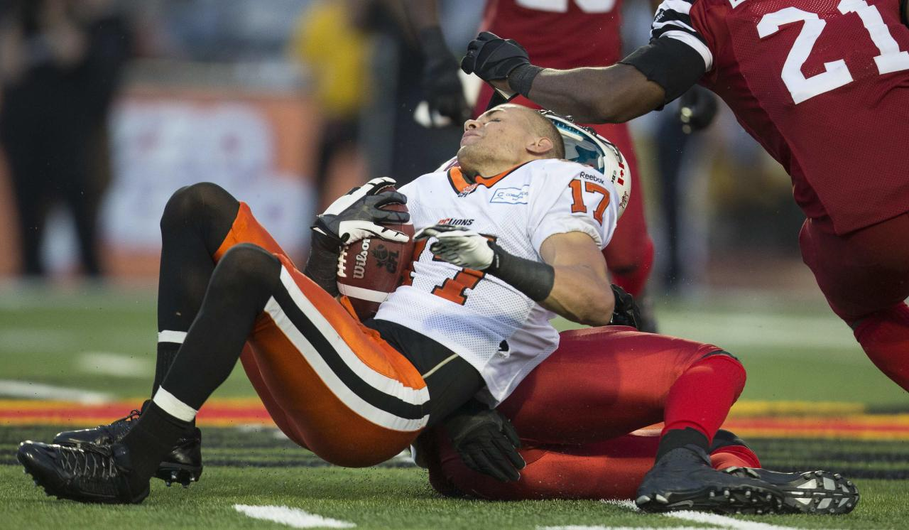 B.C. Lions slot back Nick Moore has his helmet knocked off during the Lions 37-29 loss to the Hamilton Tiger-Cats in CFL football action in Guelph, Ontario September 7, 2013. REUTERS/Geoff Robins (CANADA - Tags: SPORT FOOTBALL)