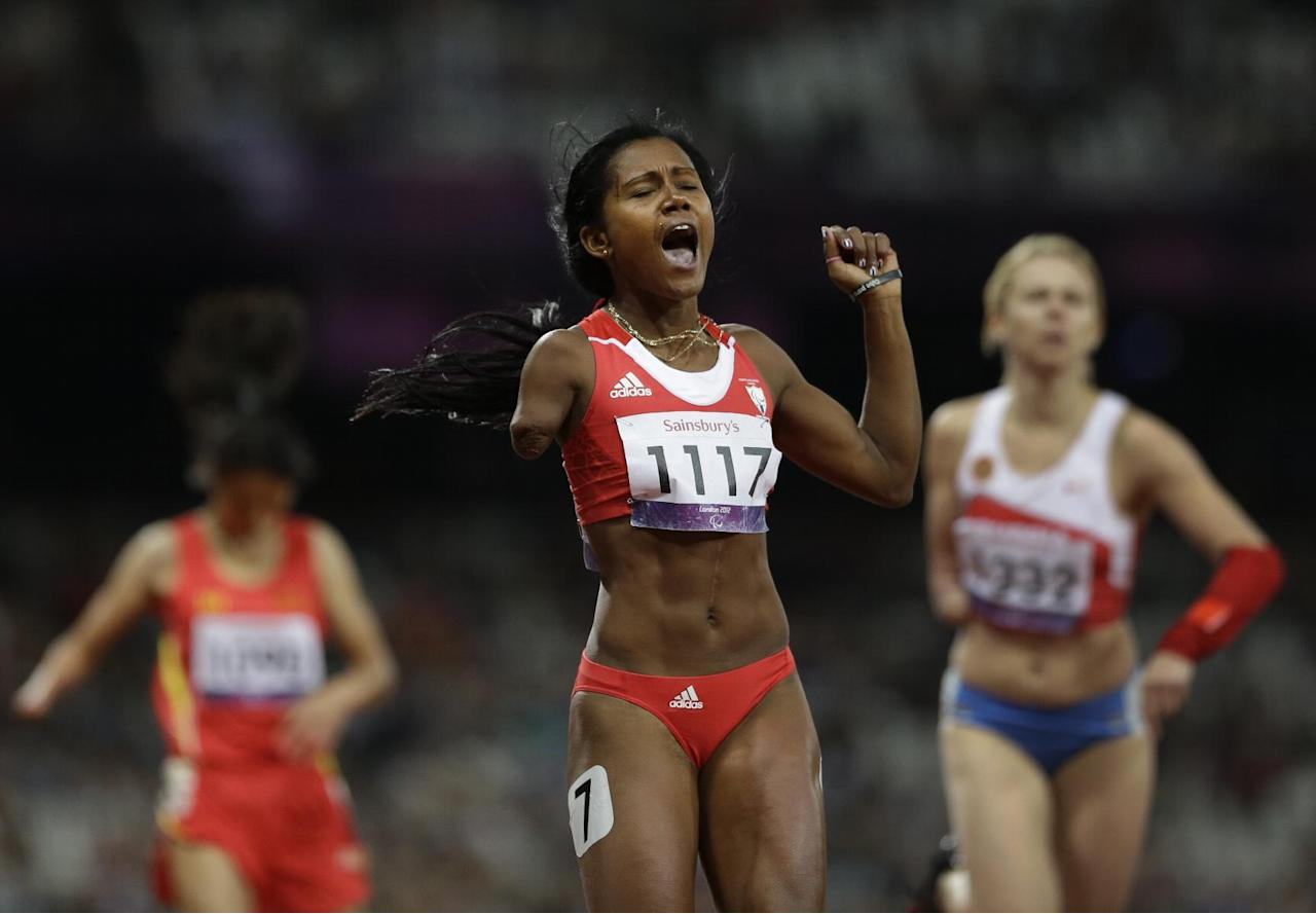 Cuba's Yunidis Castillo celebrates after winning the women's 200m T46 final race at the 2012 Paralympics in London, Saturday, Sept. 1, 2012. (AP Photo/Lefteris Pitarakis)