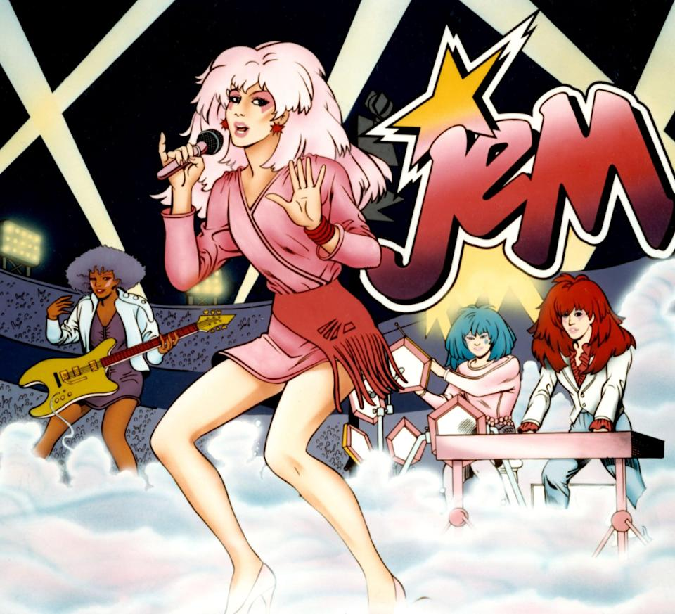 """<p>Jem and company are both exciting <em>and</em> adventurous, in case you've forgotten. Having your friends go as the Holograms is a perfect excuse to play with spray-in hair color and go crazy with the glitter face paint - which is what <a class=""""link rapid-noclick-resp"""" href=""""https://www.popsugar.co.uk/Halloween"""" rel=""""nofollow noopener"""" target=""""_blank"""" data-ylk=""""slk:Halloween"""">Halloween</a>'s really all about, anyway.</p>"""