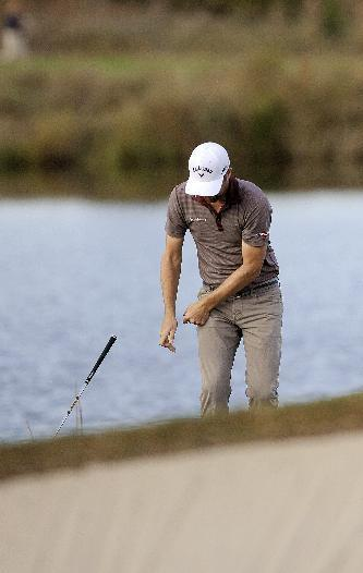 Chris Kirk throws his wedge after hitting out of the rough on the 15th hole during the final round of the McGladrey Classic golf tournament on Sunday, Nov. 10, 2013, in St. Simons Island, Ga. (AP Photo/Stephen Morton)