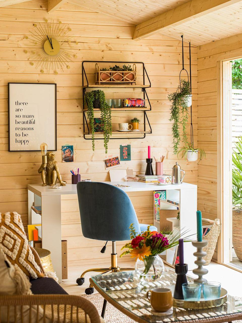 """<p>AJ has combined uplifting artwork with fun prints and quirky eye-catchers such as the <a href=""""https://go.redirectingat.com?id=127X1599956&url=https%3A%2F%2Fwww.wayfair.co.uk%2Flighting%2Fpdp%2Fworld-menagerie-marisha-32cm-table-lamp-msun6793.html%3Fpiid%3D40079204&sref=https%3A%2F%2Fwww.housebeautiful.com%2Fuk%2Fgarden%2Fg36462362%2Faj-odudu-garden-summer-house%2F"""" rel=""""nofollow noopener"""" target=""""_blank"""" data-ylk=""""slk:monkey table lamp"""" class=""""link rapid-noclick-resp"""">monkey table lamp</a>. 'For wall art you can update easily, hang up magazine clippings, postcards or prints with masking tape,' suggests Nadia McCowan Hill, Wayfair's resident style expert.</p>"""