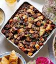 """<p>Toss dried fruits such as apricots, figs, or raisins in with the apples for an added touch of sweetness. </p><p>Get the recipe from <a href=""""https://www.delish.com/cooking/recipe-ideas/recipes/a36733/apple-walnut-stuffing-recipe-clx1114/"""" rel=""""nofollow noopener"""" target=""""_blank"""" data-ylk=""""slk:Delish"""" class=""""link rapid-noclick-resp"""">Delish</a>.</p>"""