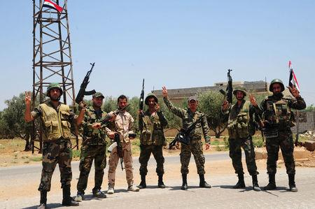 Syrian troops celebrate recapture of Jordan border crossing