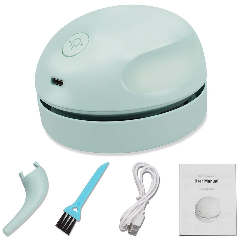"<h2>Prowithlin Desktop Vacuum Cleaner</h2><br>For those of us with desks that double as lunch tables, this mini vacuum has come to the rescue. Unlike other desk cleaning gadgets, this little guy has a detachable nozzle for keyboard crumbs and is equipped with a mini dusting brush.<br><br><em>Shop</em> <strong><em><a href=""https://amzn.to/3rVGi9t"" rel=""nofollow noopener"" target=""_blank"" data-ylk=""slk:Prowithlin"" class=""link rapid-noclick-resp"">Prowithlin</a></em></strong><br><br><strong>Prowithlin</strong> Desktop Vacuum Cleaner, $, available at <a href=""https://amzn.to/2RhBfDR"" rel=""nofollow noopener"" target=""_blank"" data-ylk=""slk:Amazon"" class=""link rapid-noclick-resp"">Amazon</a>"