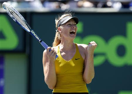 Mar 25, 2014; Miami, FL, USA; Maria Sharapova celebrates after her match against Petra Kvitova (not pictured) on day nine of the Sony Open at Crandon Tennis Center. Geoff Burke-USA TODAY Sports