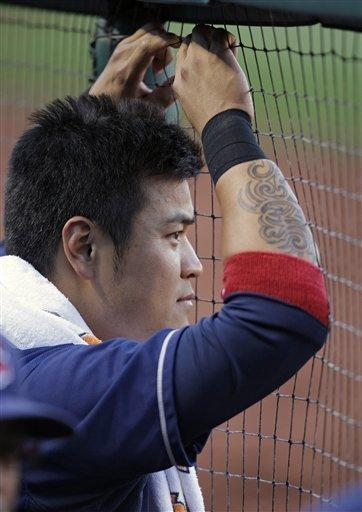 Cleveland Indians right fielder Shin-Soo Choo watches during the first inning of a baseball game against the St. Louis Cardinals, Friday, June 8, 2012 in St. Louis. (AP Photo/Tom Gannam)