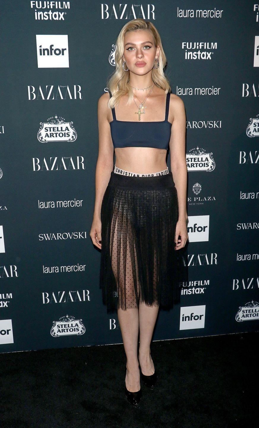 <p>The now-engaged star showed off her toned physique in a Dior two-piece consisting off a bralette and a sheer black tulle skirt. <br></p>