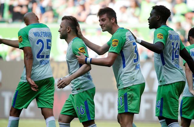 Soccer Football - Bundesliga - VfL Wolfsburg v FC Cologne - Volkswagen Arena, Wolfsburg, Germany - May 12, 2018 Wolfsburg's Robin Knoche celebrates scoring their third goal with teammates REUTERS/Wolfgang Rattay DFL RULES TO LIMIT THE ONLINE USAGE DURING MATCH TIME TO 15 PICTURES PER GAME. IMAGE SEQUENCES TO SIMULATE VIDEO IS NOT ALLOWED AT ANY TIME. FOR FURTHER QUERIES PLEASE CONTACT DFL DIRECTLY AT + 49 69 650050