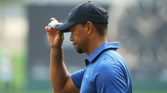 Tiger Woods acknowledges the crowd during the first round of the 2017 Omega Dubai Desert Classic.