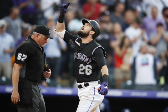 Colorado Rockies' David Dahl gestures as he crosses home plate after hitting a two-run home run off San Diego Padres starting pitcher Cal Quantrill during the third inning of a baseball game Friday, June 14, 2019, in Denver. (AP Photo/David Zalubowski)