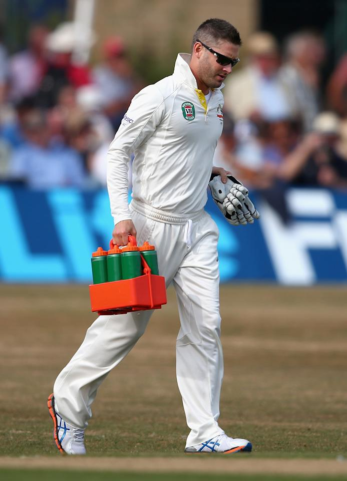 HOVE, ENGLAND - JULY 26:  Michael Clarke of Australia carries the drinks during Day One of the Tour Match between Sussex and Australia at The County Ground on July 26, 2013 in Hove, England.  (Photo by Ryan Pierse/Getty Images)