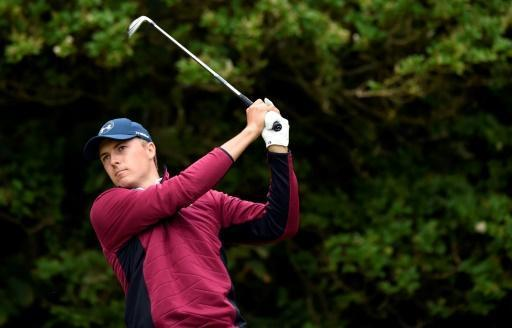 Spieth copes best in grim conditions to lead British Open