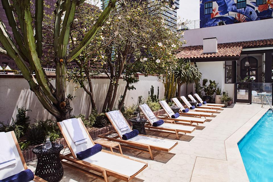 """<p>Go for a daycation without leaving the <a href=""""https://www.cntraveler.com/gallery/best-things-to-do-in-los-angeles-arts-district?mbid=synd_yahoo_rss"""" rel=""""nofollow noopener"""" target=""""_blank"""" data-ylk=""""slk:heart of DTLA"""" class=""""link rapid-noclick-resp"""">heart of DTLA</a> at the <a href=""""https://www.cntraveler.com/hotels/los-angeles/hotel-figueroa?mbid=synd_yahoo_rss"""" rel=""""nofollow noopener"""" target=""""_blank"""" data-ylk=""""slk:Hotel Figueroa"""" class=""""link rapid-noclick-resp"""">Hotel Figueroa</a> (<em>rooms from $134</em>). You can find day passes starting at $35 on ResortPass, which includes access to the hotel's iconic coffin-shaped pool, high speed wifi, complimentary towels, and valet self-parking for just $5 with validation. Make sure to grab some ceviche and tacos at the poolside Veranda Al Fresco, which also boasts an expansive margarita menu.</p> <p><strong>Reserve a spot</strong>: <a href=""""https://www.resortpass.com/hotels/hotel-figueroa"""" rel=""""nofollow noopener"""" target=""""_blank"""" data-ylk=""""slk:resortpass.com"""" class=""""link rapid-noclick-resp"""">resortpass.com</a></p>"""