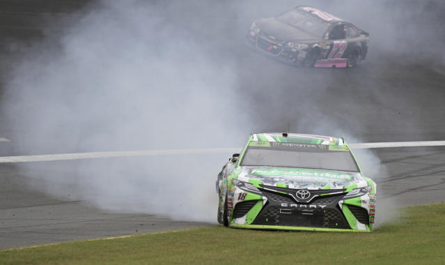 "<a class=""link rapid-noclick-resp"" href=""/nascar/sprint/drivers/947/"" data-ylk=""slk:Kyle Busch"">Kyle Busch</a> spins in Turn 2 during a NASCAR Cup Series auto race at Charlotte Motor Speedway in Concord, N.C., Sunday, Oct. 8, 2017. (AP Photo/Amanda Newman)"