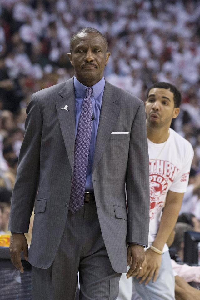Toronto Raptors coach Dwane Casey, left, and rapper Drake react during Game 1 of an opening-round NBA basketball playoff series between the Raptors and the Brooklyn Nets, in Toronto on Saturday, April 19, 2014. The Nets won 94-87. (AP Photo/The Canadian Press, Chris Young)