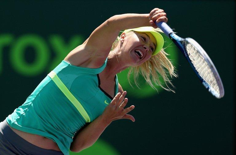 Maria Sharapova of Russia serves against Jelena Jankovic of Serbia during their semi-final match at the Sony Open at Crandon Park Tennis Center in Key Biscayne, Florida, on March 28, 2013. Sharapova won 6-2, 6-1