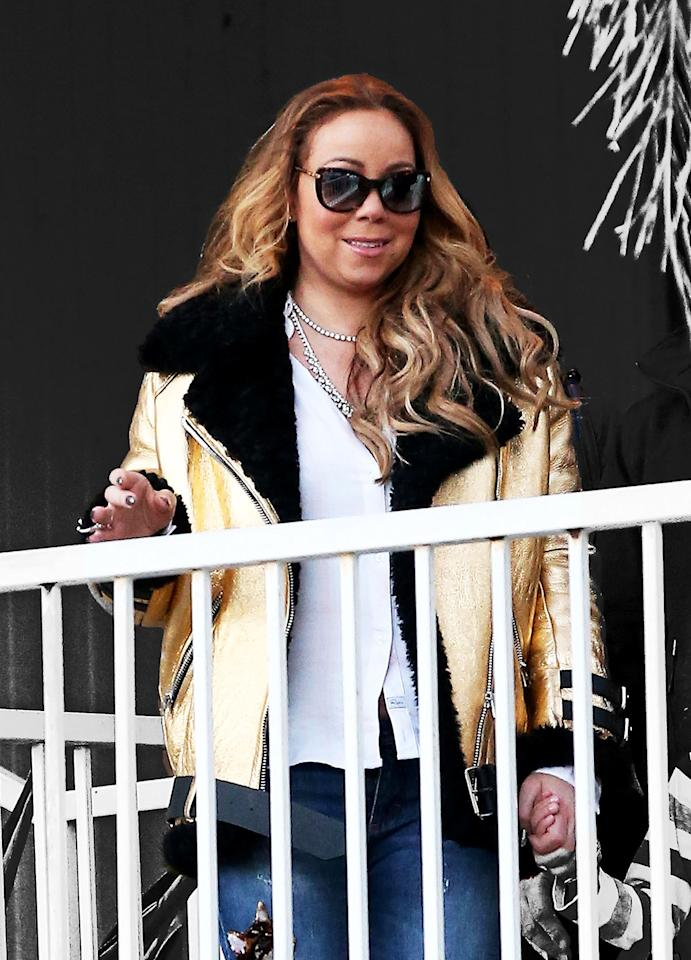 <p>Mariah Carey wore her black and gold Acne Studios Velocite Jacket with sunglasses and jewels while running errands in Los Angeles. (Photo: Fameflynet) </p>