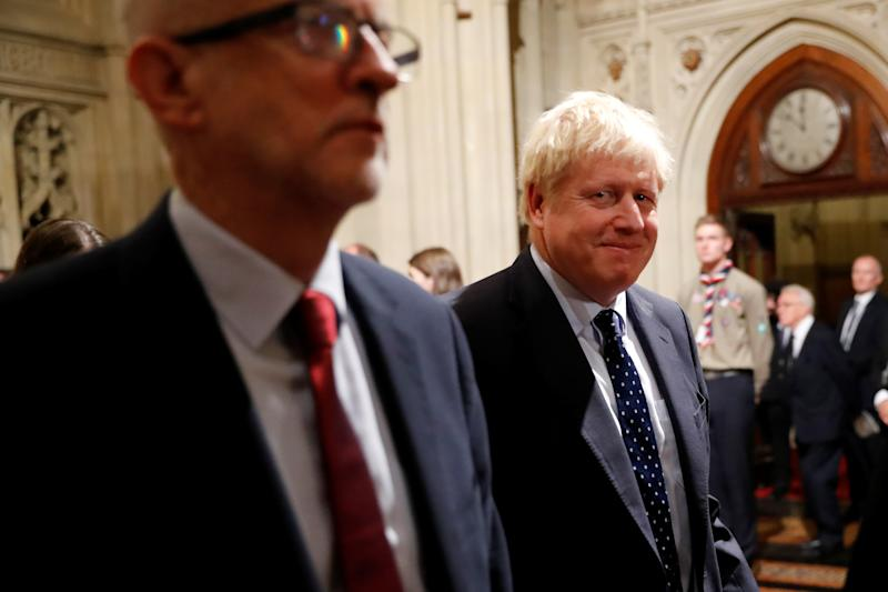 Britain's Prime Minister Boris Johnson and opposition Labour Party Leader Jeremy Corbyn walk through the Commons Members Lobby in Parliament, London, Britain, October 14, 2019. Tolga Akmen/Pool via REUTERS