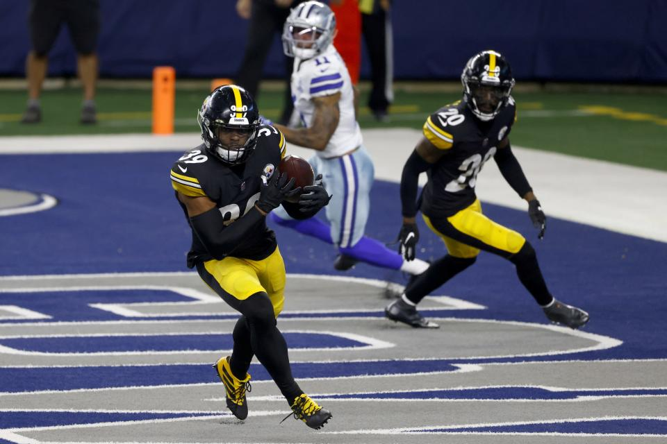 Pittsburgh Steelers safety Minkah Fitzpatrick (39) intercepts a Dallas Cowboys' Garrett Gilbert pass in the end zone as Cameron Sutton (20) and Cowboys wide receiver Cedrick Wilson (11) look on in the second half of an NFL football game in Arlington, Texas, Sunday, Nov. 8, 2020. (AP Photo/Ron Jenkins)