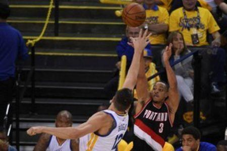 May 1, 2016; Oakland, CA, USA; Portland Trail Blazers guard C.J. McCollum (3) shoots the basketball against Golden State Warriors center Andrew Bogut (12) during the fourth quarter in game one of the second round of the NBA Playoffs at Oracle Arena.Kyle Terada-USA TODAY Sports