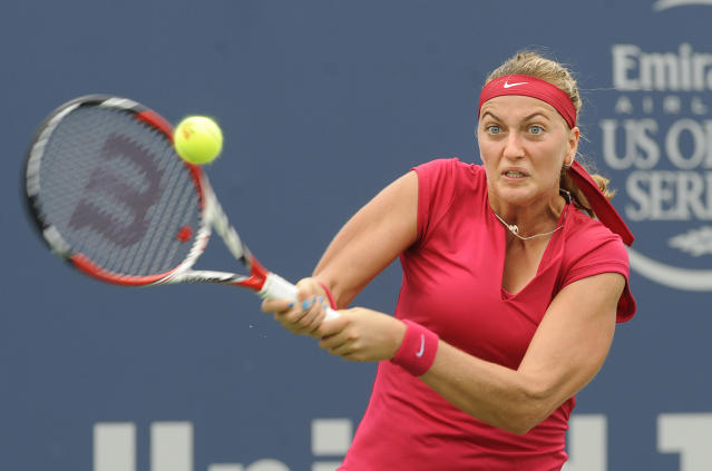 Petra Kvitova, of the Czech Republic, hits a backhand during a quarterfinal match against compatriot Barbora Zahlavova Strycov, at the New Haven Open tennis tournament in New Haven, Conn., on Thursday, Aug. 21, 2014. (AP Photo/Fred Beckham)