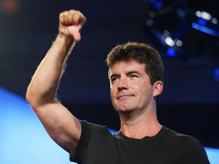 American Idol judge Simon Cowell demonstrates his style for the press at the FOX 2002 SummerTCA Tour at the Huntington Ritz Carlton Hotel in Pasadena, CA