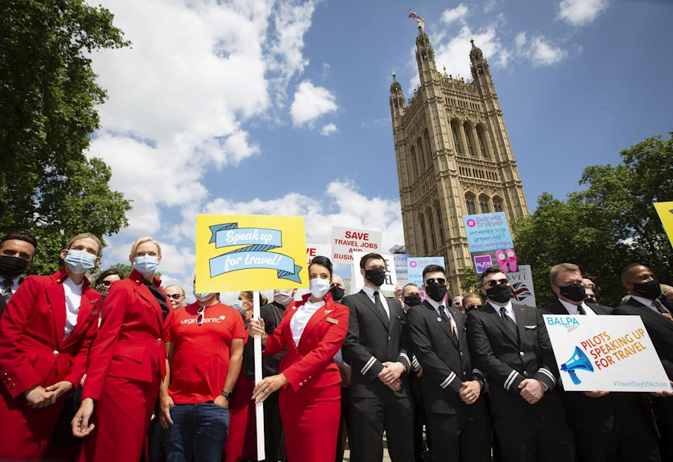 Pilots, cabin crew, ground staff and representatives from major UK airlines including easyJet, British Airways, Virgin Atlantic and TUI, along with travel agents and tour operators, attend the 'Travel Day of Action' demonstration at Westminster to put pressure on Government to safely reopen travel for this summer and provide tailored financial support to the sector, London. Picture date: Wednesday June 23, 2021. (Photo by Matt Alexander/PA Images via Getty Images)