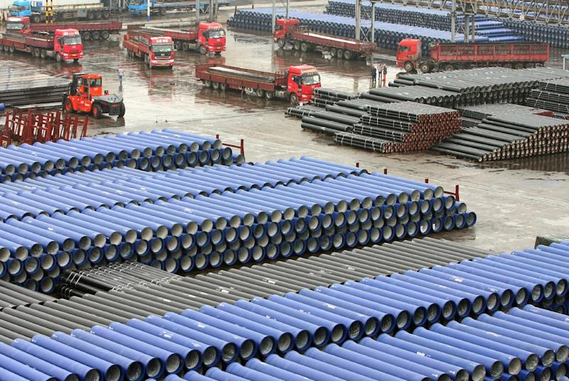 Chinese-made ductile iron pipes are displayed in Lianyungang port before being exported in Lianyungang, China's Jiangsu province on August 13, 2014 (AFP Photo/)