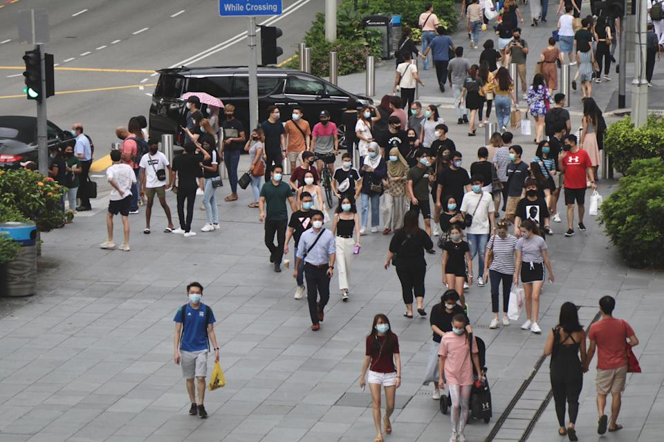 Human traffic along Orchard Road on 19 June, the first day of Singapore's Phase 2 reopening.(PHOTO:Yahoo News Singapore/Dhany Osman)