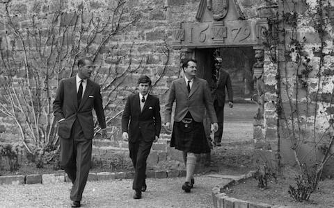 A young Prince Charles arriving for his first term at Gordonstoun school in 1962, accompanied by his father Prince Phillip. - Credit: William Vanderson /Hulton Royals Collection