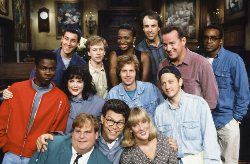 Al Franken is seen among SNL's Season 18 cast members in 1992. The women include Melanie Hutshell, seen in the bottom row to his left, Julia Sweeney, and Ellen Cleghorne. (NBC via Getty Images)