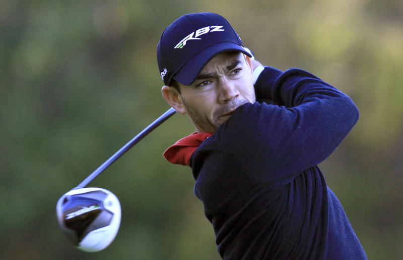 Camilo Villegas, of Colombia, hits his tee shot on the tenth hole during the first round of the Children's Miracle Network Hospitals Classic PGA Tour in Lake Buena Vista, Fla., on Thursday, Nov. 8, 2012. (AP Photo/Julie Fletcher)