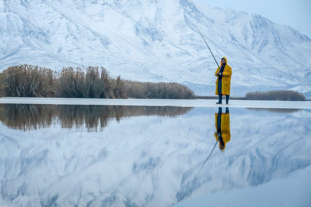 <p>A Man walk try to catch fishes on a frozen lake as it is zero celcius degree in Van, Turkey. (Ozkan Bilgin/Anadolu Agency/Getty Images) </p>