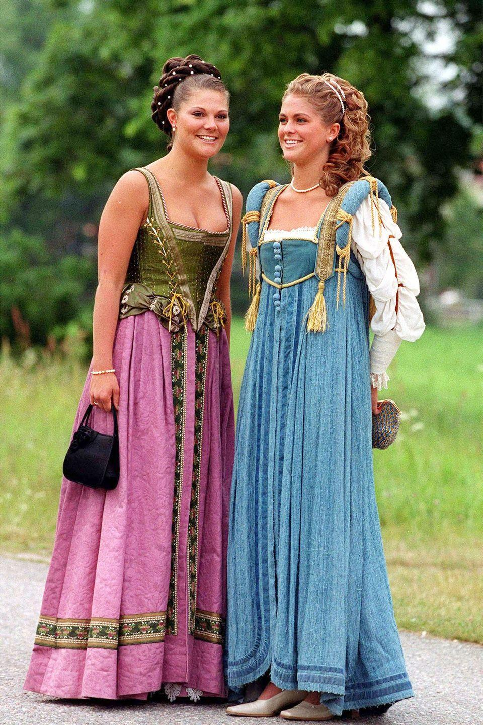<p>Sweden's Princess Victoria and Princess Madeleine in renaissance gowns at Gripsholm Castle in Sweden.</p>