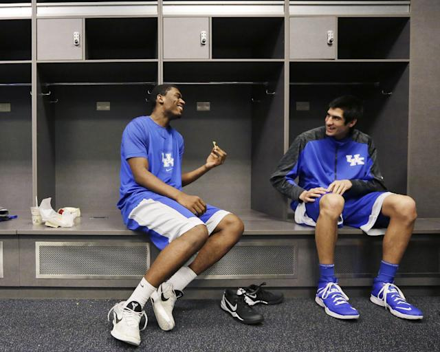 Kentucky center Dakari Johnson, left and forward Derek Willis chat in the locker room before practice for the NCAA Final Four tournament college basketball championship game Sunday, April 6, 2014, in Arlington, Texas. Kentucky plays Connecticut in the championship game on Monday, April 7. 2014. (AP Photo/Eric Gay)