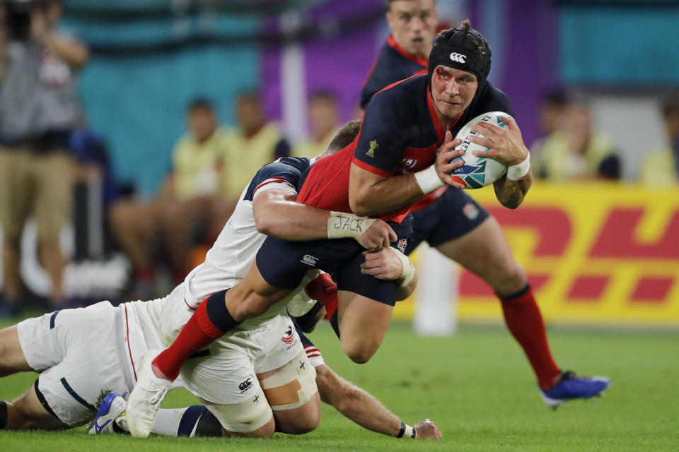 England's Piers Francis runs against the United States defense during the Rugby World Cup Pool C game at Kobe Misaki Stadium, between England and the United States in Kobe, Japan, Thursday, Sept. 26, 2019. (AP Photo/Christophe Ena)
