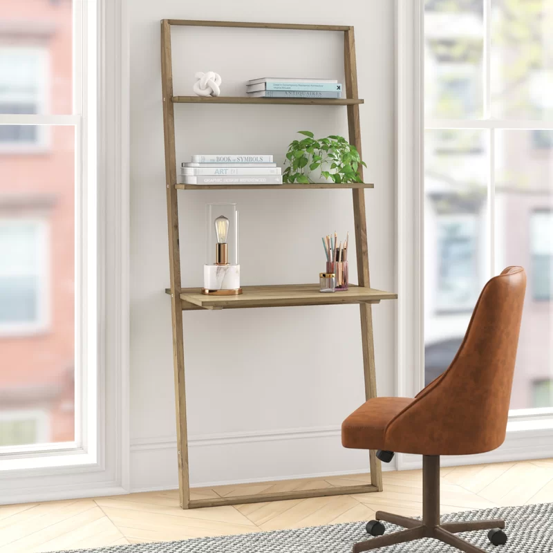 "<h3>Noelle Solid Wood Leaning Ladder Desk</h3><a href=""https://www.target.com/p/corner-desk-with-hutch-buylateral/-/A-53237557"" rel=""nofollow noopener"" target=""_blank"" data-ylk=""slk:"" class=""link rapid-noclick-resp""><br></a>If you're lacking horizontal space, then build up with a tall leaning desk that offers optimized vertical storage. <br><br><strong>Foundstone</strong> Noelle Solid Wood Leaning/Ladder Desk, $, available at <a href=""https://go.skimresources.com/?id=30283X879131&url=https%3A%2F%2Fwww.wayfair.com%2Ffurniture%2Fpdp%2Ffoundstone-noelle-solid-wood-leaningladder-desk-w002047357.html"" rel=""nofollow noopener"" target=""_blank"" data-ylk=""slk:Wayfair"" class=""link rapid-noclick-resp"">Wayfair</a>"
