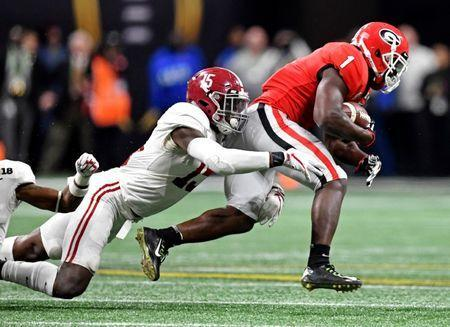 Jan 8, 2018; Atlanta, GA, USA; Georgia Bulldogs running back Sony Michel (1) runs the ball against Alabama Crimson Tide defensive back Ronnie Harrison (15) during the fourth quarter in the 2018 CFP national championship college football game at Mercedes-Benz Stadium. Mandatory Credit: John David Mercer-USA TODAY Sports