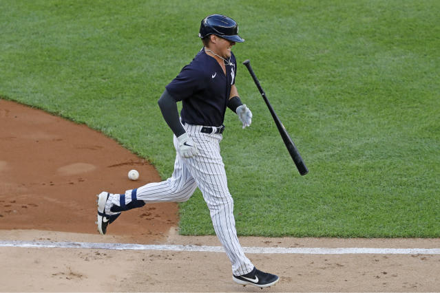 New York Yankees' Luke Voit tosses his bat after he was hit by a pitch thrown by James Paxton during an intrasquad baseball game at practice Wednesday, July 15, 2020, at Yankee Stadium in New York. (AP Photo/Kathy Willens)