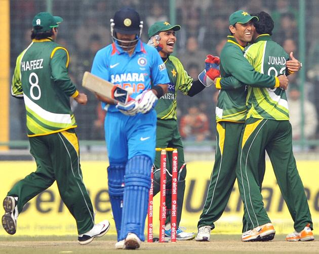 Pakistan players celebrating the wicket of Virat Kohli (India) during the 3rd One Day Internationals Match between India & Pakistan at Ferozeshah Kotla Stadium in Delhi on January 6, 2013. P D Photo by Asish Maitra